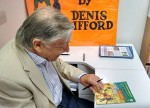 Alan is reluctant to sign on the front cover.....